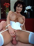 A cougar with a slight tan gets her rocking body slammed in white lingerie