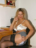 Horny mature blonde posing on the desk with her legs wide open to show her juicy pussy