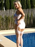 Naughty blonde mature housewife shows her bare ass by the pool and plays with her cunt
