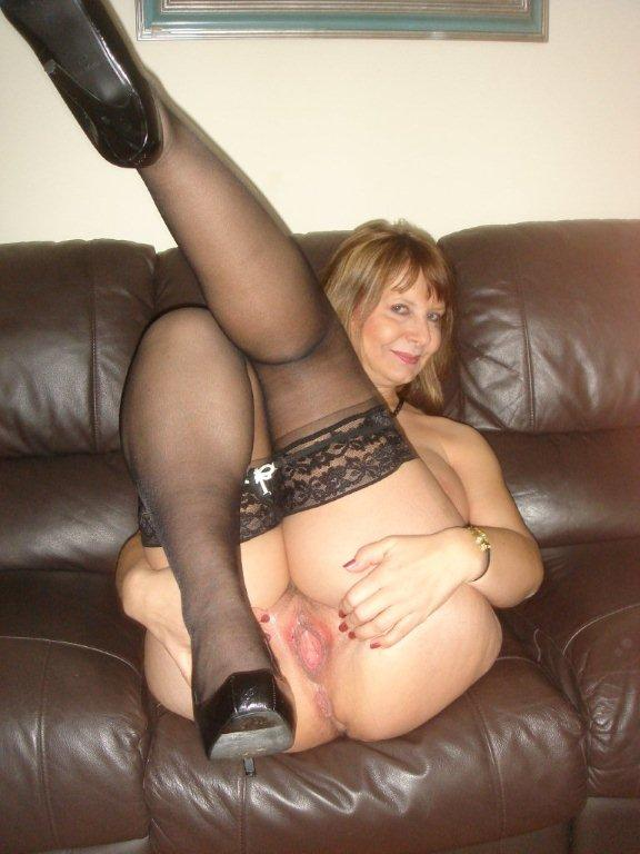 Mature blond in stockings gets black cocked