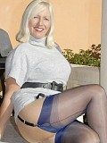 Slutty and horny Sandy flaunts her incredible body in blue stockings