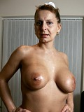 Hot pictures of a mature blonde showing off her huge natural tits in sexy poses