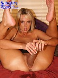 Incredibly flexible blonde bitch shoves a gigantic black dildo inside her with her legs behind her head