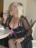 Sassy blonde mature milf loves to show off her hot body in sexy black lingerie