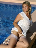 Kinky mature housewife exposes her pussy by the pool while in stockings