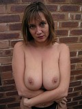 Wild brunette housewife gets crazy and shows her massive tits outdoors