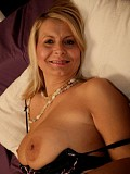 Wild blonde housewife gets horny and spreads wide open on the bed to finger herself