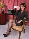 Gorgeous mature brunette gets naughty in her sexy black outfit and stockings