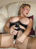 Frisky mature housewife getting crazy on the floor playing with a huge dildo