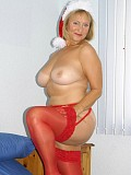 Ravishing mature blonde posing as a naughty Mrs. Santa in red stockings