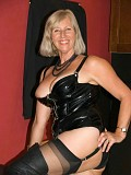 Wild blonde mature chick loves to get crazy posing in her sexy latex outfit