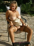 Gorgeous busty mature housewife loves posing topless in her garden showing off her boobs