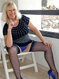 Stunning pictures of a horny blonde housewife wearing hot blue stockings and taking them off