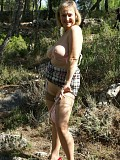 Ravishing blonde mature housewife flashes her juicy ass in the woods