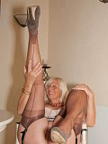 Sassy mature blonde Sandy loves posing in hot stockings and flaunting her juicy big ass