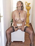Naughty blonde Michelle loves to finger her juicy pussy while posing in stockings