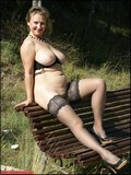 Horny Michelle loves to pose naked on the bench where she can get caught