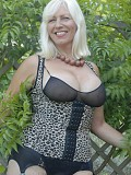 Ravishing blonde milf flaunts her killer tits in a sexy corset outdoors