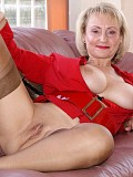 Hot blonde mature milf posing in a sexy red outfit and playing with a hard dick