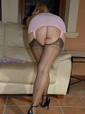 Sassy blonde mature milf takes her clothes off to reveal her sexy black stockings