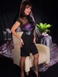 Ravishing brunette milf seduces by posing in silk lingerie and hot stockings