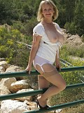 Chunky blonde milf Michelle reveals a pair of incredibly big tits in an outdoors picture set
