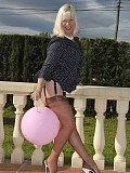Kinky blonde housewife shows her juicy ass in stockings while playing with a balloon