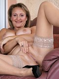 Incredibly hot pictures of a busty mature babe sucking off her husband