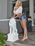 This gorgeous blonde bimbo wears a tight pair of daisy dukes to show off