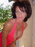 This brunette babes tits nearly explode out of her tight and tiny pink dress