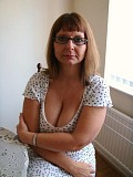 Amazing pictures of a mature blonde flaunting her incredible massive tits