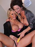 Two lesbian cougars get freaky and bust each other out of their tight suits