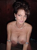 Fine as all fuck MILF gets busy with her monstrously large tits and her hot cunt