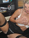 Horny blonde secretary strips naked and squeezes her massive tits on camera